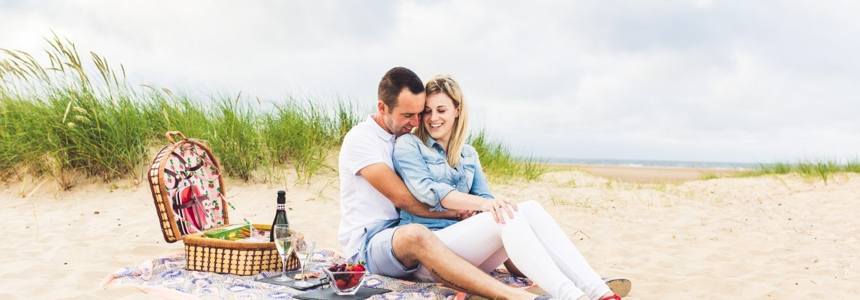 An engagement shoot on Holkham beach by Norfolk wedding photographer Jamie Groom